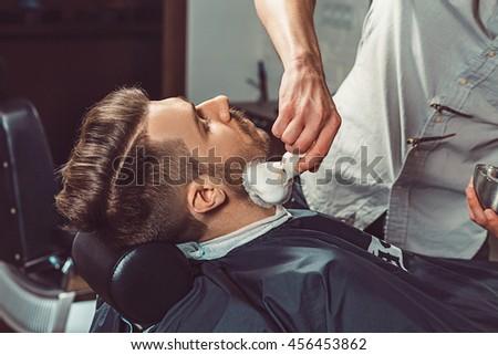 hipster client visiting barber...