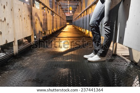 Hipster concept - Person hanging out on bridge in a night time setting