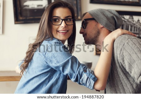 Hipster couple flirting at cafe