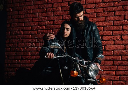 hipster couple. hipster couple riding on motorbike. hipster couple on brick wall background. road trip of hipster couple. planning week #1198018564