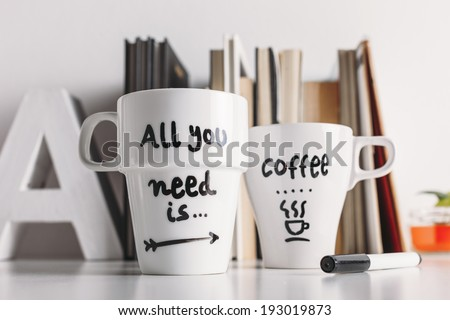 Hipster cup of coffee on a books library./ Close up of two white coffee mug with diy decoration.  #193019873