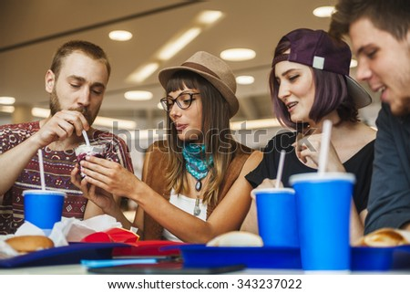 Hipster Friends In Mall Eating Fast Food #343237022