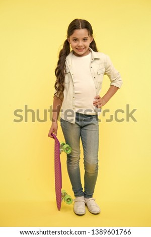 hipster girl. hipster girl with penny board. hipster girl hold penny board for training. sport activity of hipster girl. fashionable teen