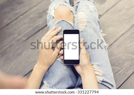 Hipster girl with blank cell phone, mock up #331227794