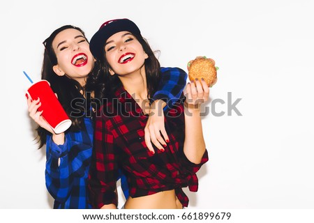 Hipster girls with vegetarian burger drinking a cocktail from straw and having fun, happy, smile and laugh on the white background. #661899679