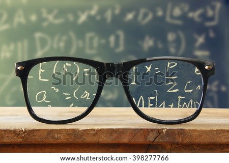 hipster glasses on a wooden...