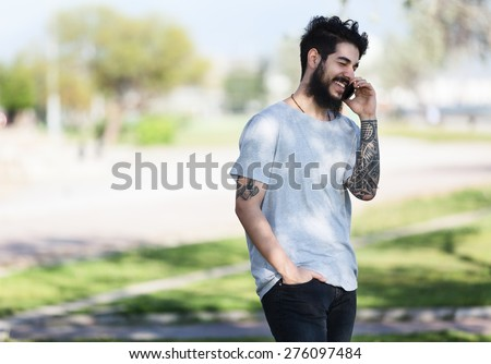 hipster guy with tattooed arm using a laptop.focus on keyboard stock photo