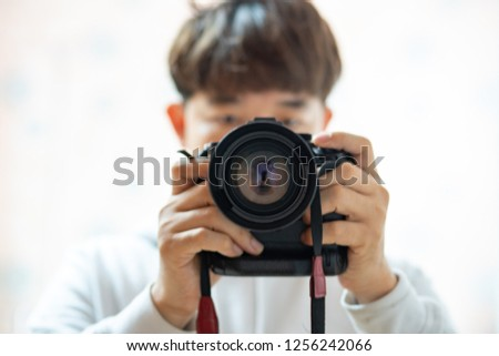 hipster image. a man use camera for taking himself in the mirror. male photographer taking a picture with camera. selective focus. Selfie.