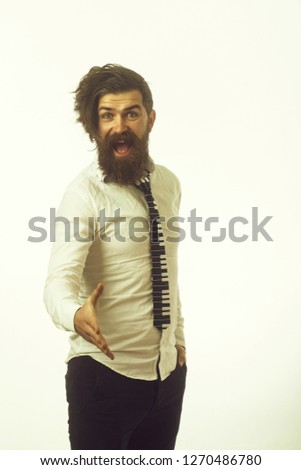 Hipster in shirt and musical tie. Guy hold hand for handshake. Business fashion and beauty. Fashion model with stylish hair isolated on white. Man with long beard and mustache on happy face. #1270486780