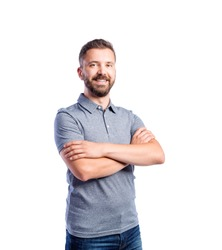 Hipster man in gray t-shirt, studio shot, isolated