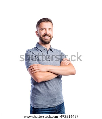Hipster man in gray t-shirt, studio shot, isolated Foto stock ©