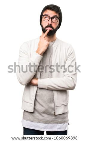 Hipster man thinking on white background #1060069898