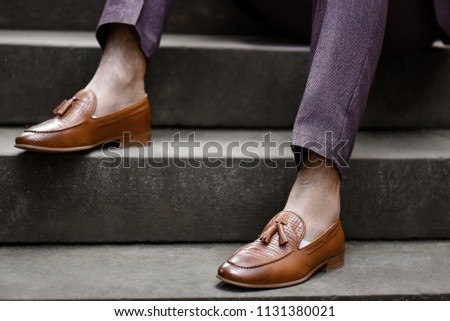 Hipster man wear fashion shoes tassel loafer.On old  floor. Stylish men shoes concept.