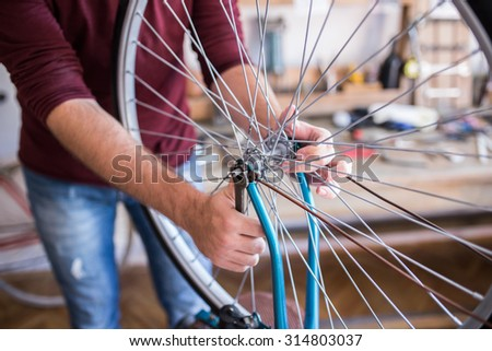 hipster man working in bike...