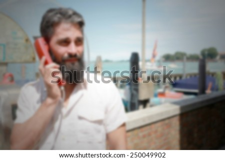 Hipster on cable phone. Intentionally blurred editing post production background.