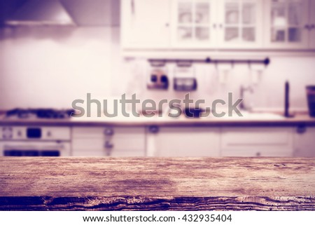 hipster photo of kitchen interior with white furniture and dark desk