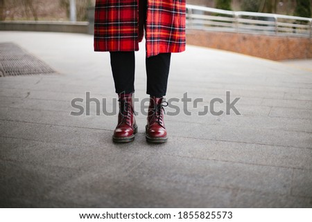 Hipster wearing red trendy boots and coat trench gray background Stock photo ©
