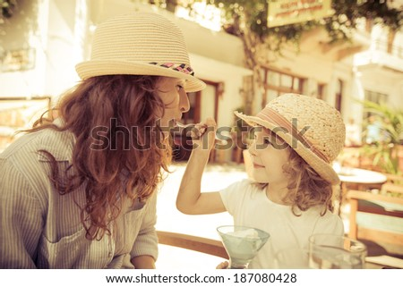 hipster woman and girl in...