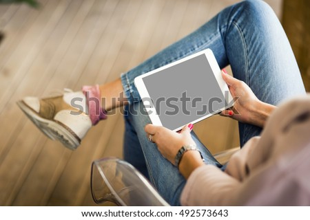 Hipster woman hands holding digital tablet with empty blank screen for your text message, business person browsing internet or connecting to wireless via touchscreen pad  #492573643