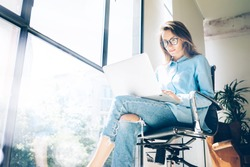 Hipster Woman use Laptop huge Loft Studio.Student Researching Process Work.Young Business Team Working Creative Startup modern Office.Analyze market stock,new strategy.Blurred,film effect.Horizontal
