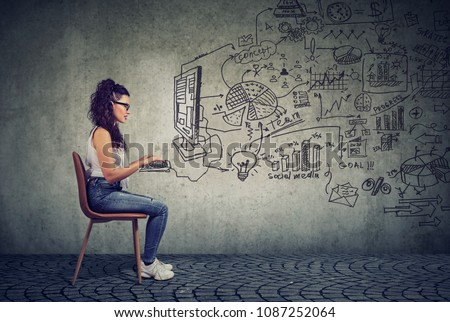 Hipster young business woman working in an office on computer brainstorming a start up plan
