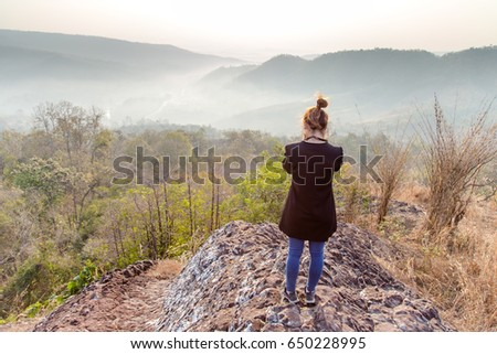 Hipster young girl taking photo in beautiful nature