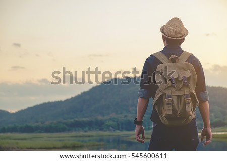 hipster young man with backpack ...