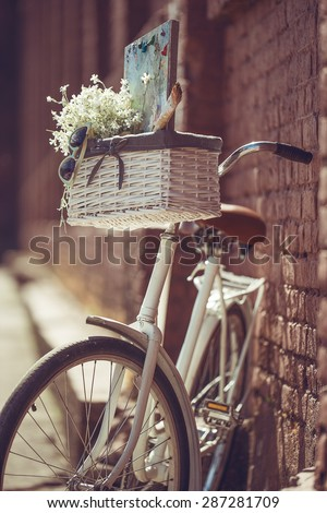Hipsters bike with a basket of flowers and art design  #287281709