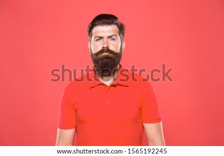 Hiring barber. Barber career. Barber salon. Man bearded hipster with long beard and mustache on red background. Hairstyle is kind of art. Well groomed hipster. Barbershop concept. Facial hair care.