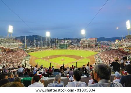 HIROSHIMA, JAPAN - JULY 14: The Hiroshima Toyo Carp vs. the Yokohama Baystars, member teams of Nippon Professional Baseball, at Mazda Stadium on July 14, 2011 in Hiroshima, Japan.