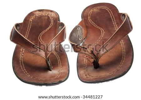 His favorite pair of leather sandals / flip flops.  Worn in, isolated on a white background