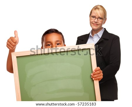 Hispanic Boy Holding Chalk Board with Thumbs Up and Female Teacher Behind Isolated on a White Background.