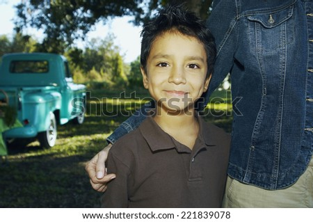 hispanic boy with truck in...