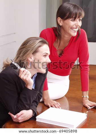 Hispanic business colleagues working at office.