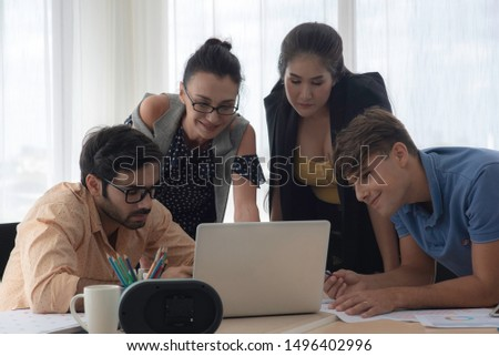 Hispanic businessman holding papers hands and smiling.Young team of coworkers making great business discussion in modern coworking office.Teamwork people concept.Horizontal, blurred background, flares #1496402996