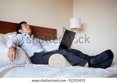Hispanic businessman resting in his hotel room