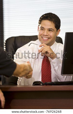 Hispanic Businessman Shaking Hands in the Office