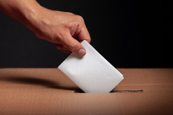 hispanic choosing their vote in latin american political elections on a black background