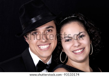 Hispanic couple in love on black background