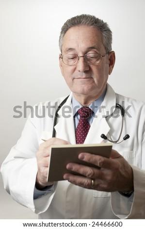 Hispanic doctor physician writing prescription vertical