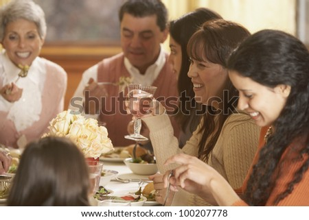 Hispanic family eating at the dinner table - stock photo