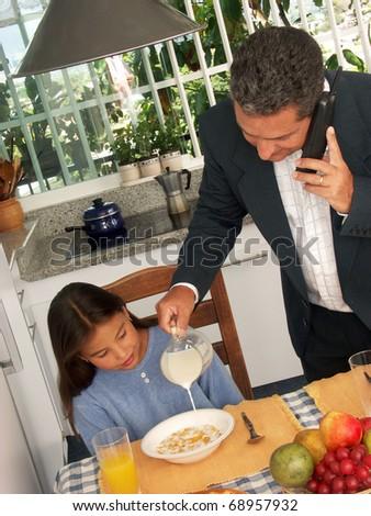 Hispanic family having breakfast in a kitchen.