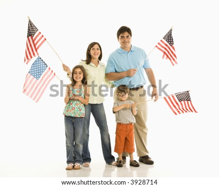 Hispanic family holding American flags.