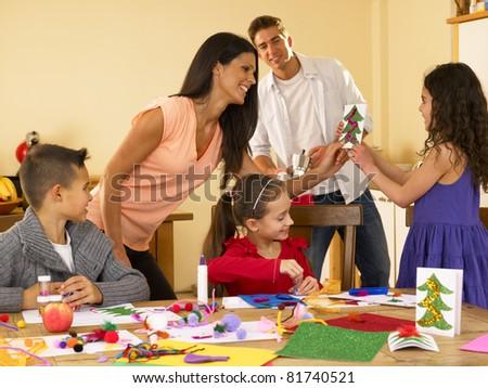 Hispanic Family Making Christmas Dinner