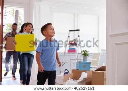 Hispanic Family Moving Into New Home