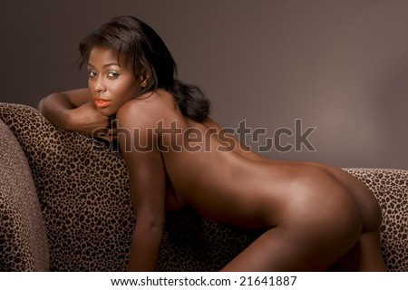 Hispanic hot nude woman on couch in sensual erotic seductive pose, demonstrating her perfectly shaped buttocks