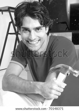Hispanic man holding a hummer .