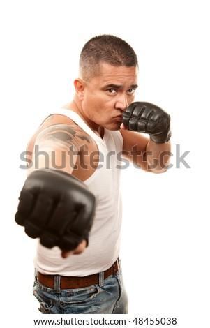 Hispanic man in t-shirt wearing mixed martial arts gloves