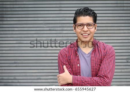 Hispanic man wearing glasses portrait #655945627