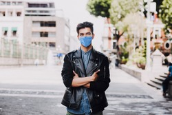 hispanic man wearing mask face to prevent infection or respiratory illness, Mexican man with Protection against contagious coronavirus in Mexico Latin America